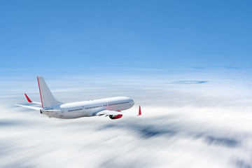 White airplane flying above cloud at daytime with motion blur effect