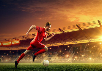 Soccer player in action on a stadium. Dribble the ball. Soccer game. Sports championship. Soccer field.