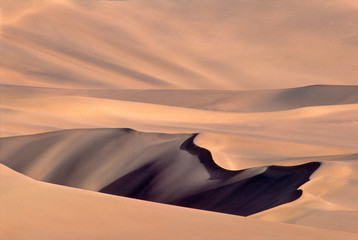 Asia, China, Dunhuang. These immense sand dunes are a popular tourist attraction at Dunhuang in Gansu Province, China.