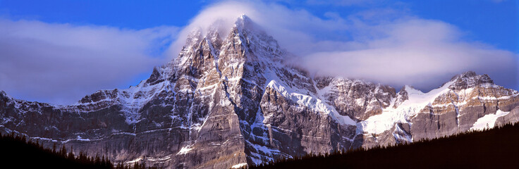 Canada, Alberta, Mt. Chephren. Mount Chephren wears a mantle of clouds in Banff NP, a World Heritage Site, Alberta, Canada.