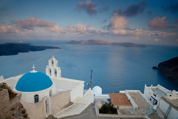 Greece, Santorini. Bell tower and blue domes of church in village of Firostefani