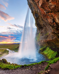 Instagram format 5x7 photo landscape in natural post-processing - Seljalandsfoss waterfall in Iceland, picturesque sunset scene. White nights summer time in Iceland.