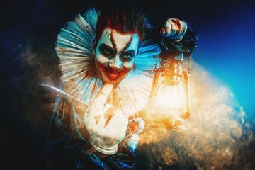 klaun z latarnią