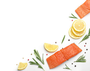 Composition with fresh raw salmon fillets on white background, top view. Space for text