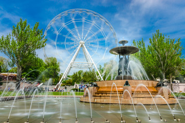 Rostov-na-Donu, Theatre square famous fountain with Atlants and Ferris wheel