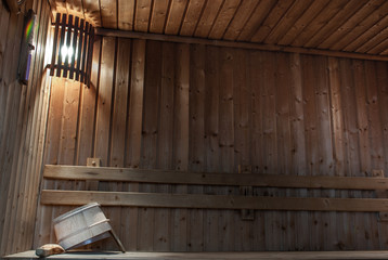 Wooden sauna interior, relaxation concept.
