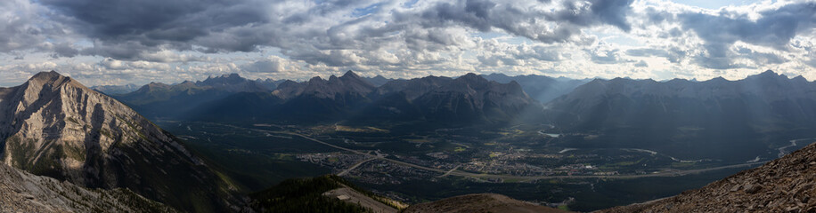 Beautiful Panoramic View of Canadian Rocky Mountain Landscape during a cloudy and rainy day. Taken from Mt Lady MacDonald, Canmore, Alberta, Canada.