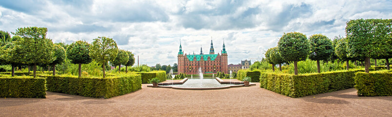 beautiful landscape with fountain and magical incredible gardens and park Frederiksborg slot Castle near Copenhagen. Hillerod, Denmark. Exotic amazing places. Popular tourist atraction.