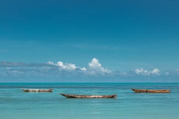 Empty wooden boats on ocean