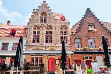 Old brick restaurant buildings in Bruges city