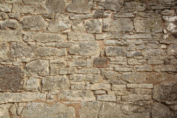 rough sandy texture of an old medieval stone wall. Background for design, close-up, copy space
