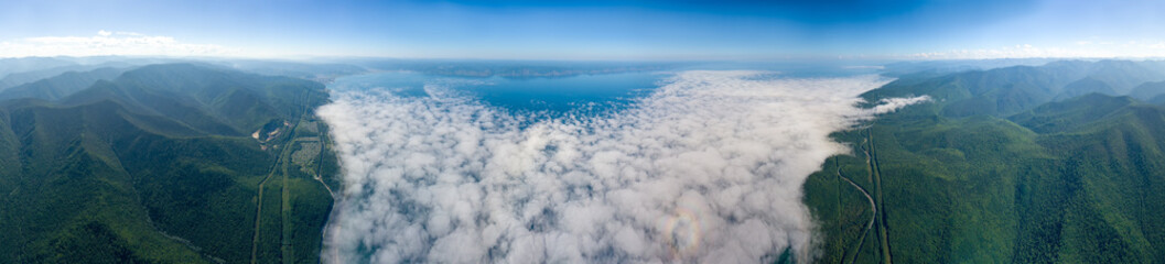 Circular 360 Panorama of Lake Baikal, shot above the clouds. Mountains covered with forest around