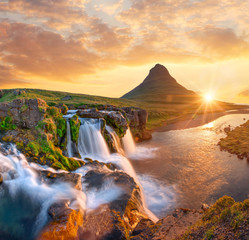 Beautiful landscape with sunrise on Kirkjufellsfoss waterfall and Kirkjufell mountain, Iceland, Europe.
