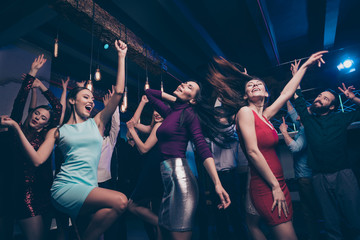 Nice gorgeous adorable attractive glamorous slim fit thin cheerful glad positive stylish girls and guys having fun occasion festal celebratory feast in fashionable luxury place nightclub indoors