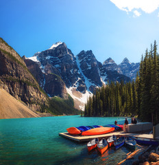 Canoes on a jetty at Moraine lake in Canada