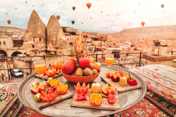 Travel in Cappadocia Colorful hot air balloons flying over the valley sunrise time with .special breakfast travel destination in Turkey