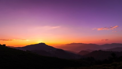Beautiful landscape purple sky and sunrise on the mountain with foggy.