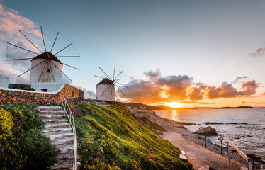 The white windmills of Mykonos Island, famous Mykonos sunset, Kato Mili close to Little Venice, Cyclades, Greece