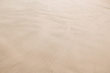 Sandy shore patterns texture , nature beach background