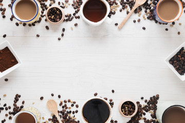 various-types-coffee-raw-coffee-beans-roasted-coffee-beans-coffee-powder-arranged-white-table