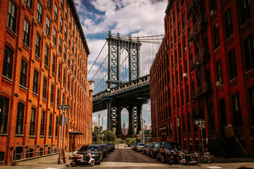 Manhattan bridge seen from a Washington Street in Brooklyn street in perspective