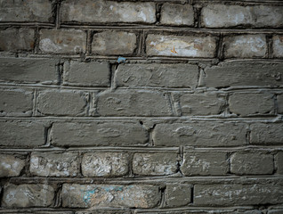 Texture of an old paint covered brick wall. Background image of an abandoned brick wall with painted over paint