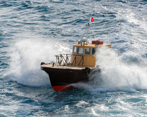 Boat plowing through the waves