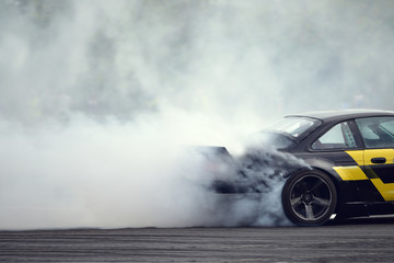 Motion blur close up drift car with  smoke from burning tires