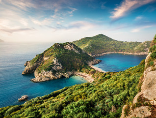 Fabulous spring view of Pirates Bay, Afionas village location.Perfect morning seascape of Ionian Sea. Fantastic outdoor scene of Corfu island, Greece, Europe. Beauty of nature concept background.