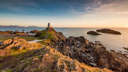 Light house at sunset in Wales