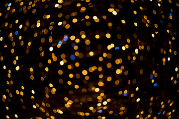 Fabulous bokeh of small gold circles with blue inclusions, twisted into a circle.