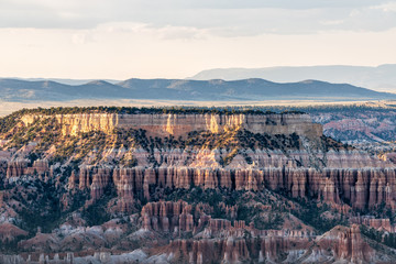 High angle view from Bryce Point overlook of hoodoos rock formations in Bryce Canyon National Park at sunset with sunlight