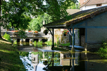 Lusigny sur Ouche old Wash-house (Lavoir) in Burgundy. River and antique bridge.