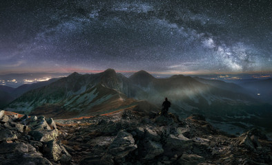 Tatras mountain panorama at night with milky way, Slovakia from peak Hruba Kopa in Rohace