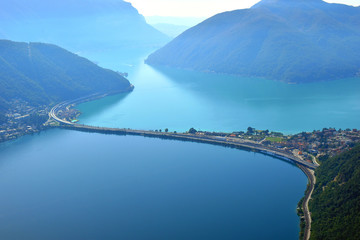 View of Lake Lugano panorama from Monte San Salvatore Bridge over Lake Lugano in Switzerland.