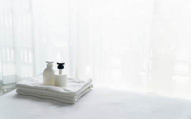 Liquid soap and shampoo bottle in bedroom. Hygiene and healthy life concept.
