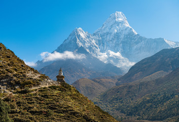 The Buddhist stupa at the edge of the mountain with beautiful with of Mt.Ama Dablam one of the most beautiful mountain in the World. View on the way to Everest Base Camp, Nepal.