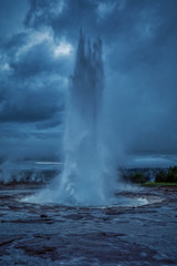 Amazing shot of erupting strokkur geyser, located in a geothermal area beside the Hvita River