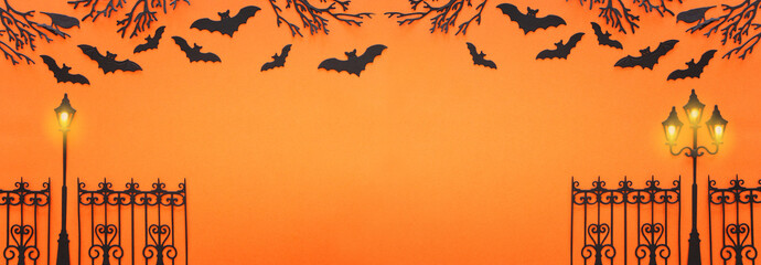 holidays Halloween concept. haunted alley with trees and bats over orange background. Top view, flat lay