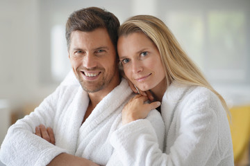 Young casual couple in white bathrobe