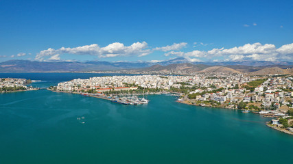 Aerial photo of famous seaside town of Halkida with beautiful clouds and deep blue sky, Evia island, Greece