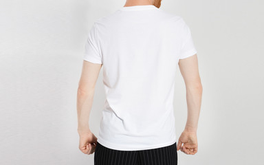 white t-shirt on a young caucasian man isolated. Ready for your design. Man in blank t shirt mock up
