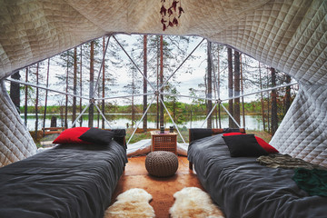 Transparent panoramic window in a big tent with a forest view
