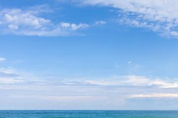 Sea water under cloudy blue sky