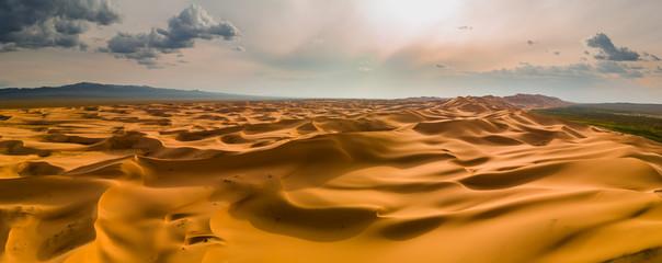 Sunset over the sand dunes in the desert