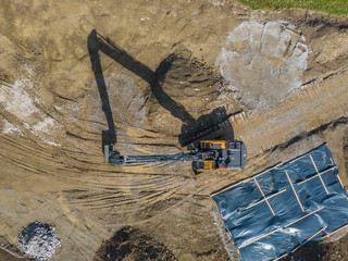 Aerial view of large excavator on construction site.
