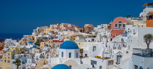 Pastel colorful lovely mediterranean city of Oia Santorini in Greece