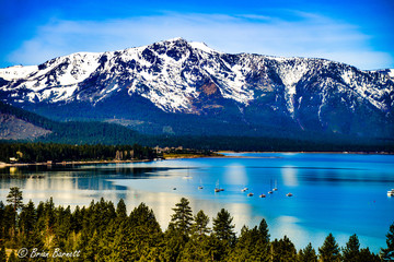 Lake Tahoe in the spring with snow covered Sierra Nevada Mountains