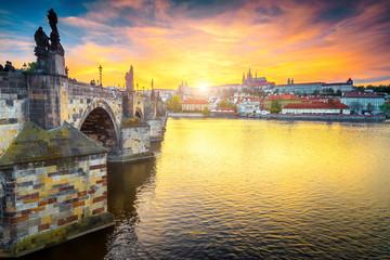Medieval pedestrian stone Charles bridge at sunset, Prague, Czech Republic