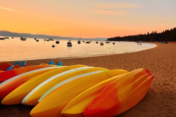 colorful kayaks resting on the beach